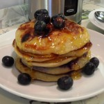 Blueberry & Banana Pancakes American Style with golden syrup and blueberries
