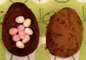 Chocolate Easter Egg filled with speckled eggs