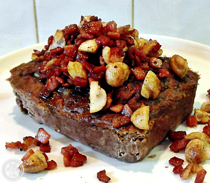 Leverpostej (Danish Liver Pate) with fried mushrooms & bacon on a serving dish.