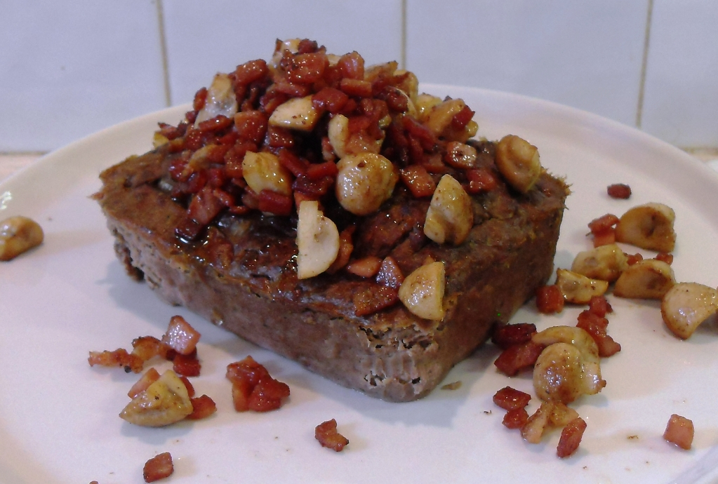 Leverpostej (Danish Liver Pate) topped with fried chopped bacon & mushrooms.
