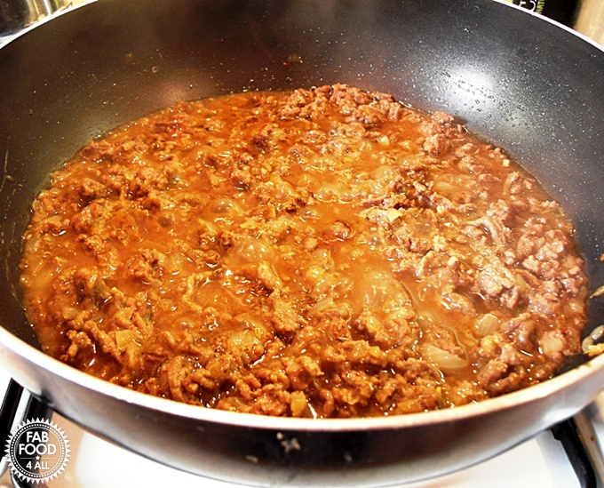 Minced beef & onions in a non-stick pan.