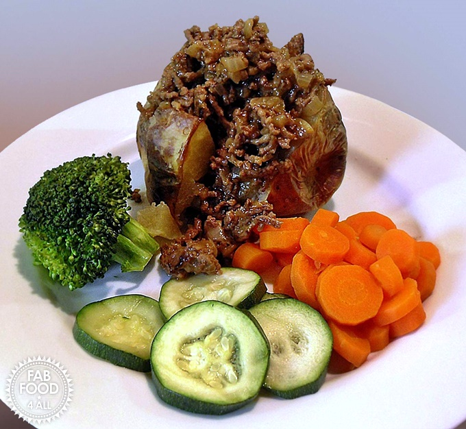 Minced Beef & Onions with jacket potato, carrots, courgette & broccoli.
