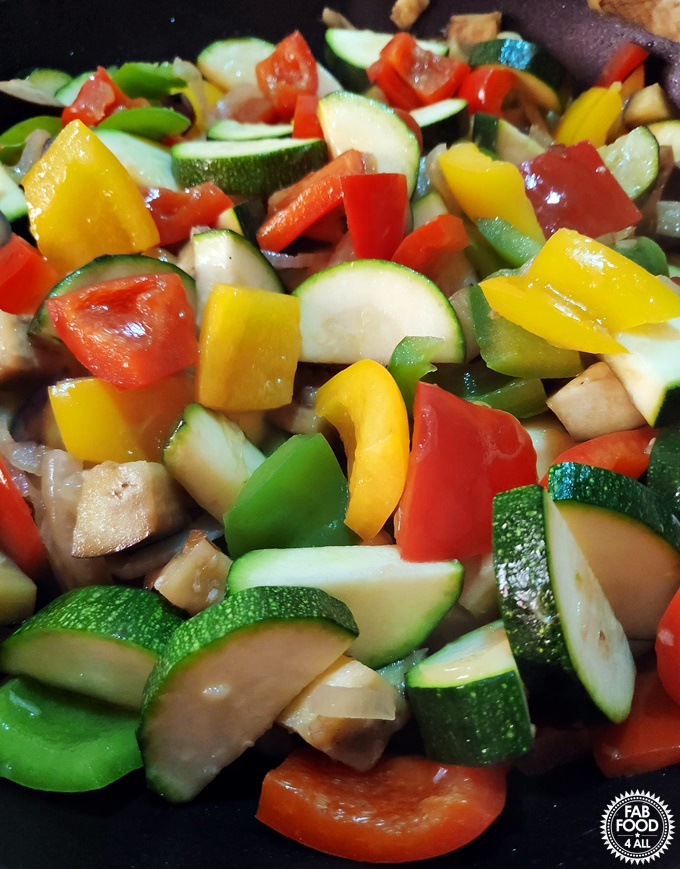 Simple Ratatouille close up in a pan. of raw ingredients