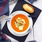 Tomato, Carrot and Dill Soup - creamy, garlicky & delicious! This soup was a best seller when I worked in catering and a personal favourite! #tomato #carrot #dill #soup #souprecipes #tomatorecipes #carrotrecipes #vegetarianrecipes #vegetarian #vegetablesouprecipes #vegetablesoup