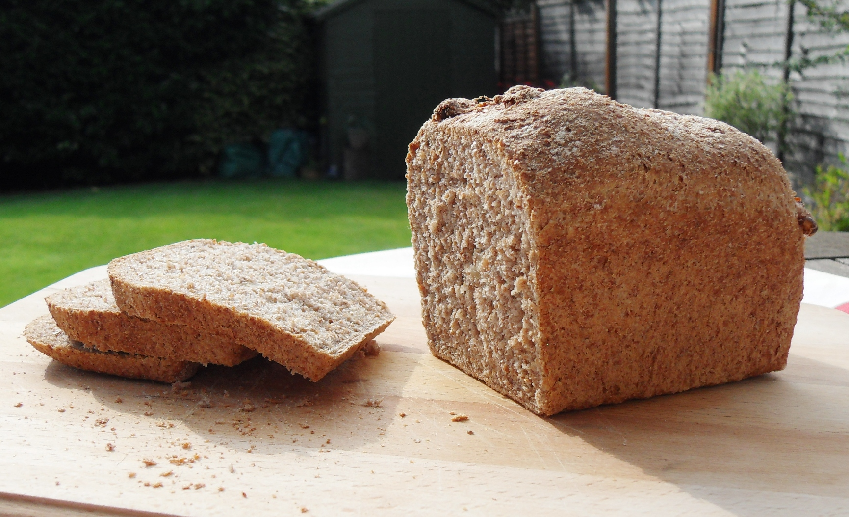 Walnutty Wholemeal Bread on a board in garden.