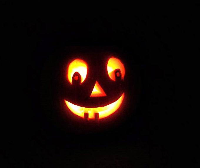 Smiley pumpkin face in the dark.