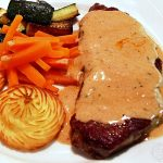 Steak with Whisky Sauce plated up with Duchess potatoes, carrots & fried courgettes.