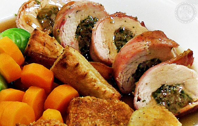 Stuffed Turkey Breast Steaks in Blankets sliced with gravy & vegetables.