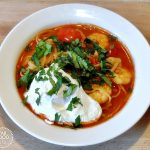 Tom Yum Soup with Poached Egg in a bowl.
