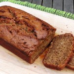 Spelt Banana Bread sliced on a wooden board.