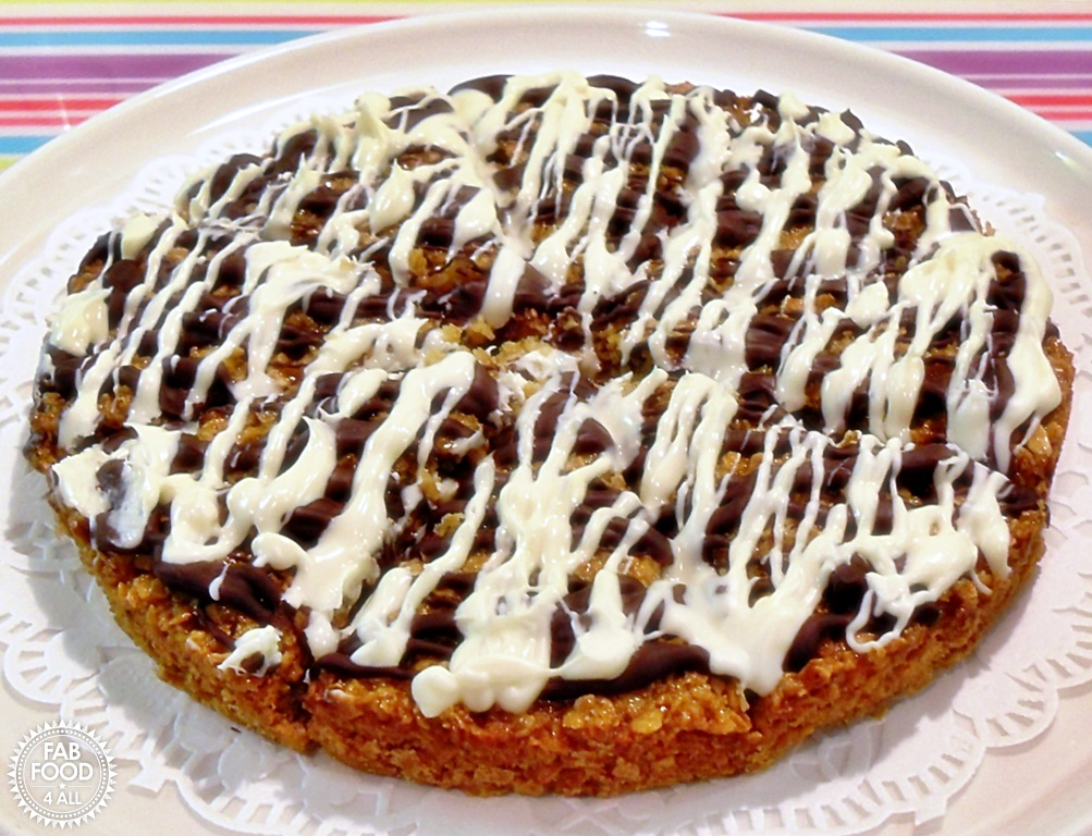 Chocolate Drizzle Flapjacks - topped with white and dark chocolate! A favourite from childhood! #Flapjacks #OatRecipes #DarkChocolate #WhiteChocolate #kidsbaking #kidsrecipes #RetroRecipes #LadybirdBooks #baking #easybaking