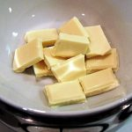 White chocolate being melted over a pan of hot water.