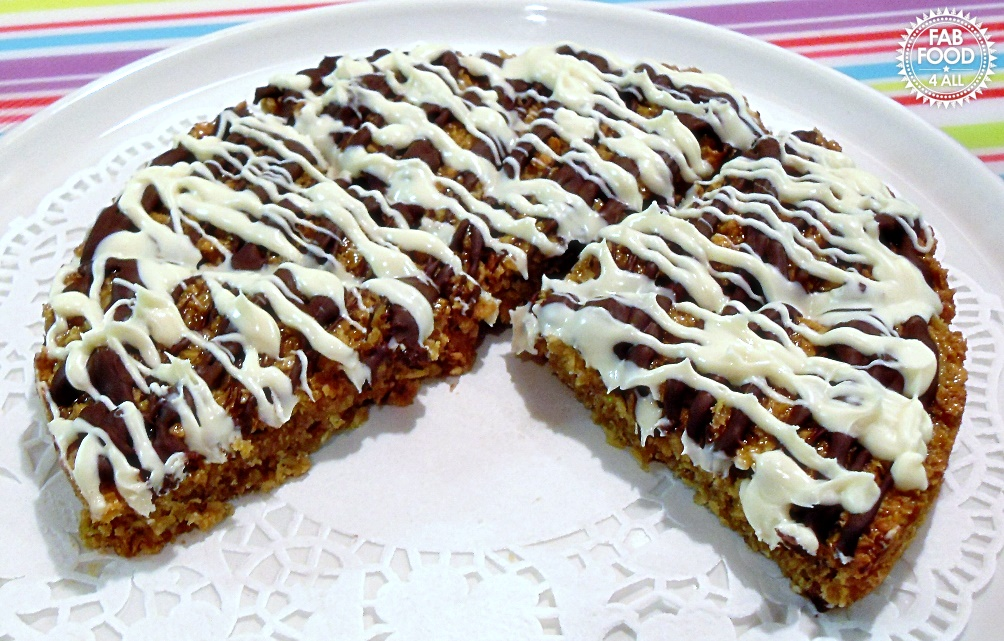 Chocolate Drizzle Flapjacks on platter with doily.