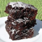 3 Specunana Brownies stacked on a plate.