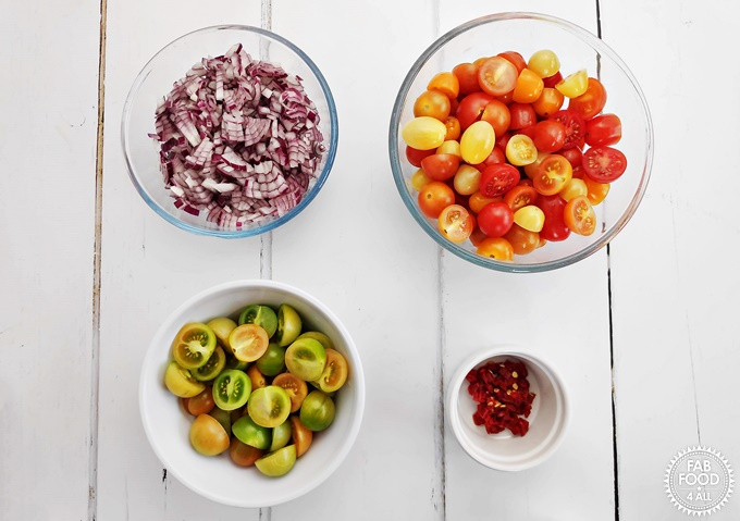 Chopped red onion, cherry tomatoes, green cherry tomatoes & red chilli pepper.