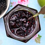 Easy Blackberry & Apple Jam in jar with spoon.