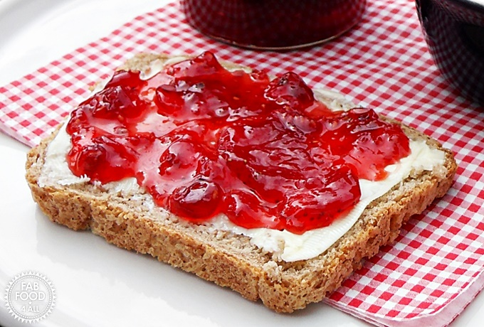 Strawberry, Raspberry & Redcurrant Jam on bread and butter.