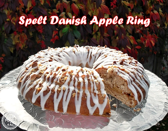 Spelt Danish Apple Ring with slice cut out.