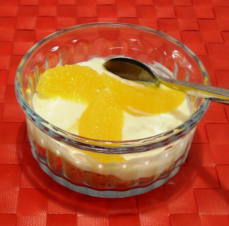 Instant Orange Cheesecakes in glass ramekin.