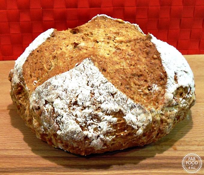 Emmental Soda Bread Loaf on a wooden board.