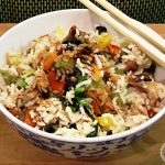 Simple Pork Fried Rice in a bowl with chopsticks.