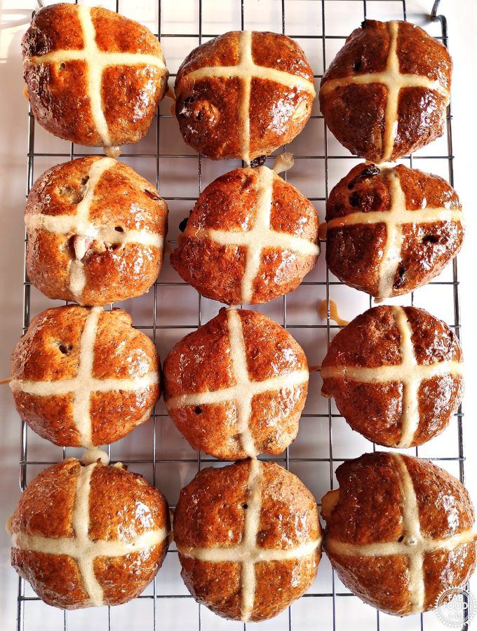 Wholemeal Apple Hot Cross Buns on a wire rack - aerial view.