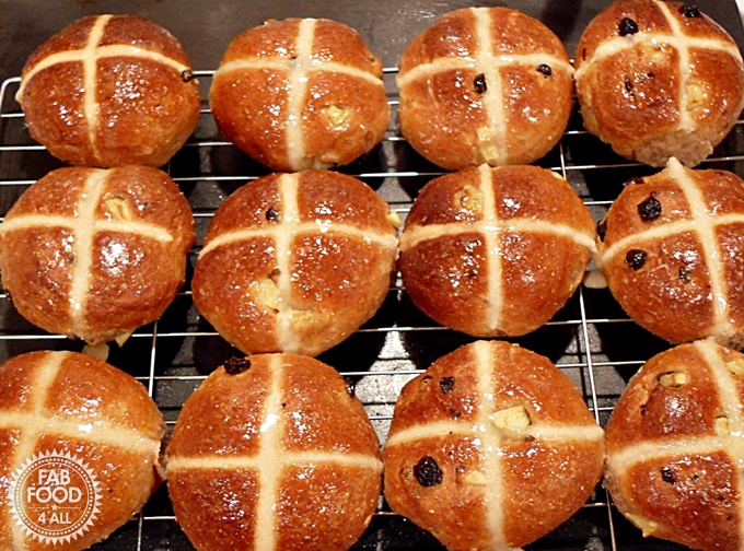 Wholemeal Apple Hot Cross Buns cooling on a rack.
