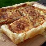 Quiche Lorraine with Slow Cooked Pulled Gammon on a wooden board.