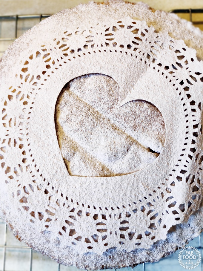 Victoria Sandwich doily template with heart cut out.