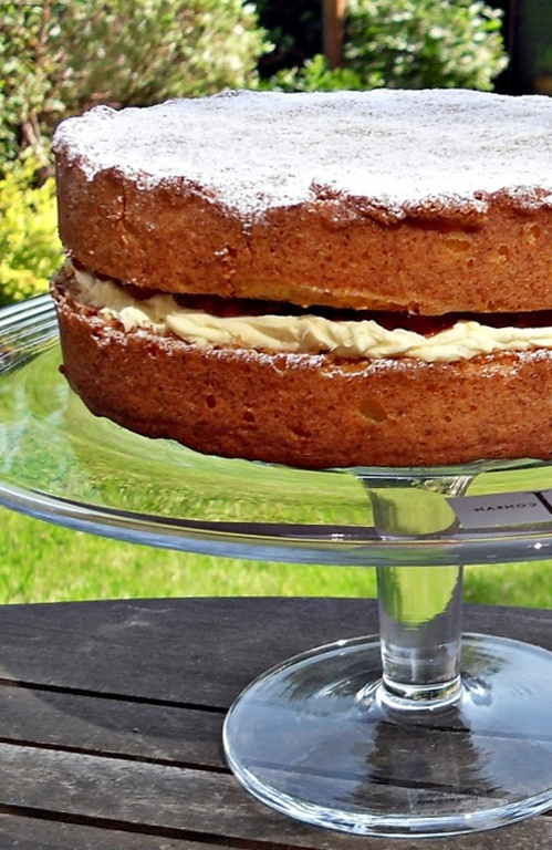 Victoria Sandwich on a glass pedestal.