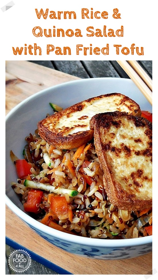 Warm Rice & Quinoa Salad with Pan Fried Tofu in a bowl with chopsticks