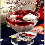 A portion of Risalamande (Danish Rice Pudding) and cherry sauce in a glass sundae dish. Pinterest image.