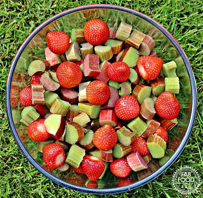 A bowl of chopped rhubarb and strawberries.