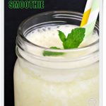 Pineapple & Coconut Smoothie in glass mug with sprig of mint & 2 straws. Pinterest image.