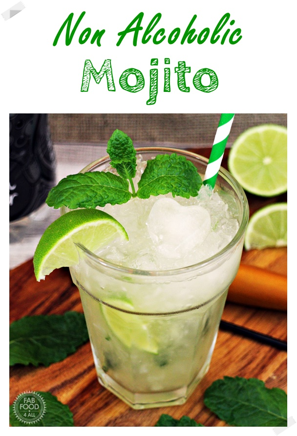 Non Alcoholic Mojito in a glass with crushed ice, stripey green straw, wedge of lime & spring of mint.