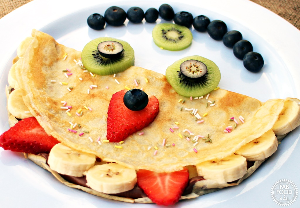 Monster Panccakes -with kiwi, blueberry, strawberry & banana faces.