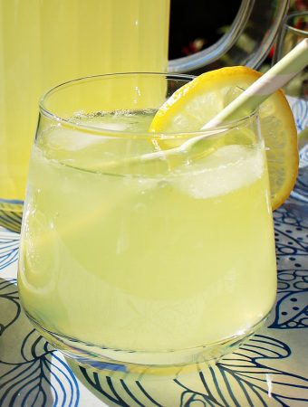 Old Fashioned Lemonade in a glass with ice and lemon.