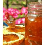 Greengage Jam in a jar with scones on a board. Pinterest image.