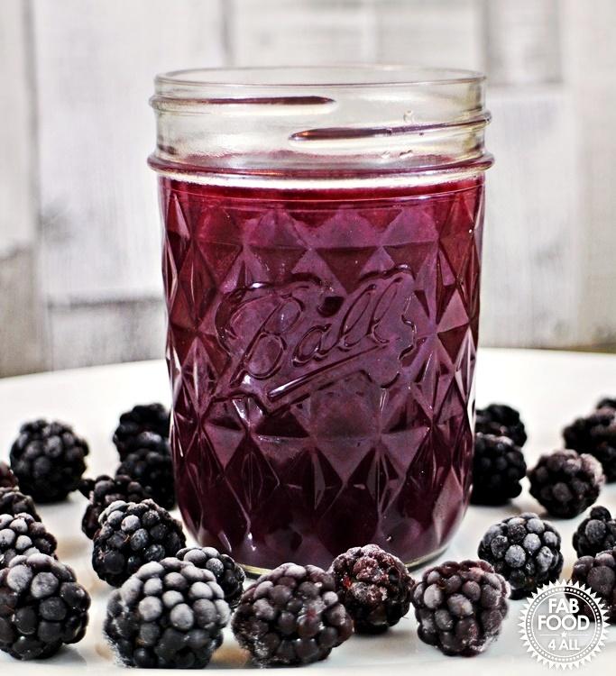 Easy Blackberry Curd in a jar with blackberries.