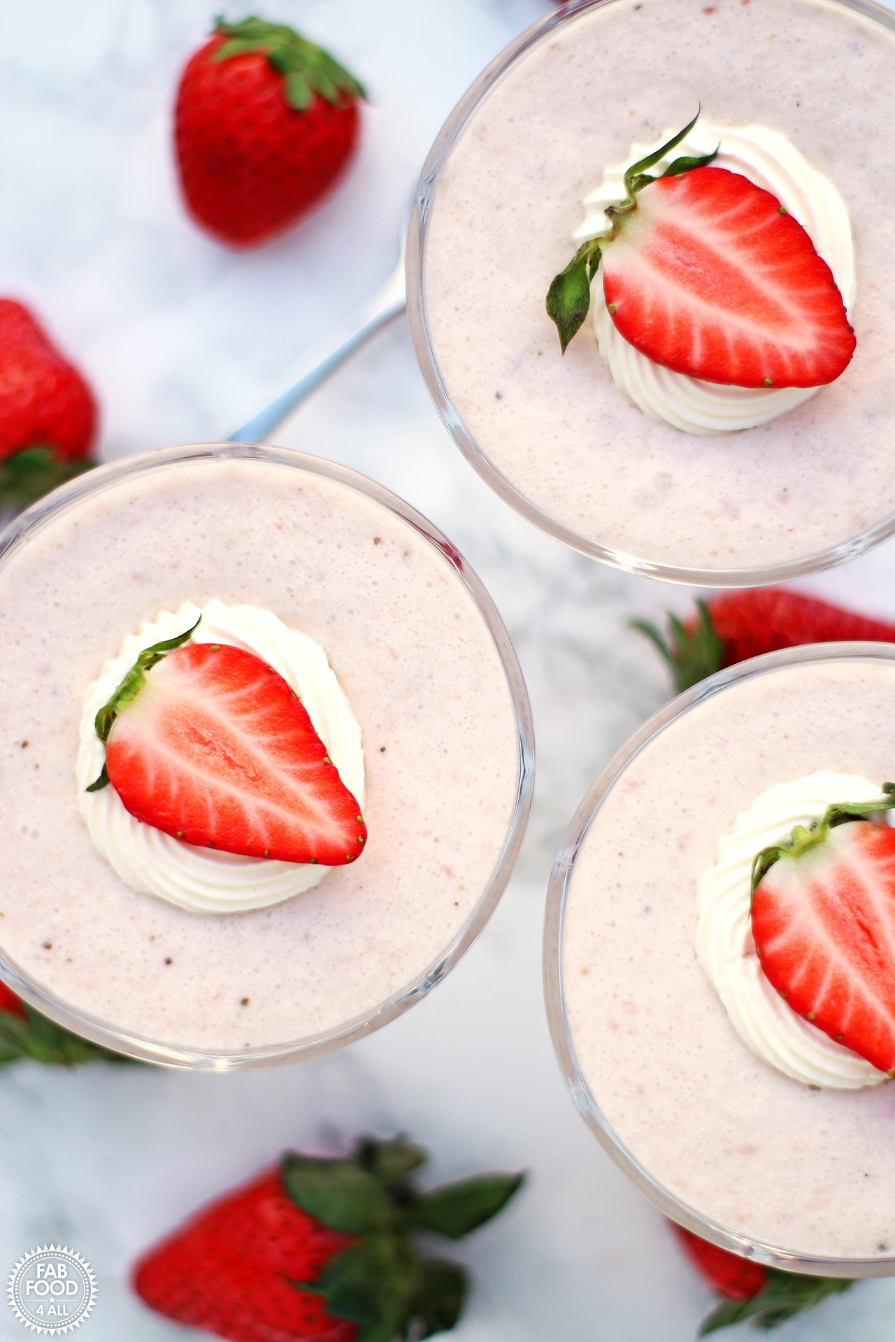 White Chocolate & Strawberry Mousse in glass goblets, overhead shot.
