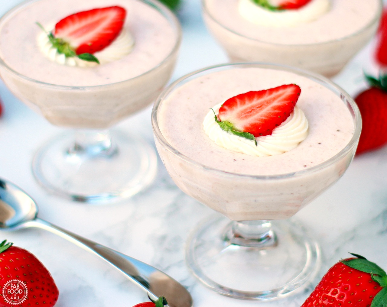 White Chocolate & Strawberry Mousse in glass goblets.