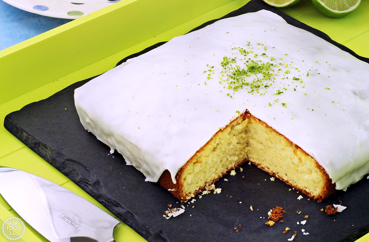 Iced Lime cake with slice removed.