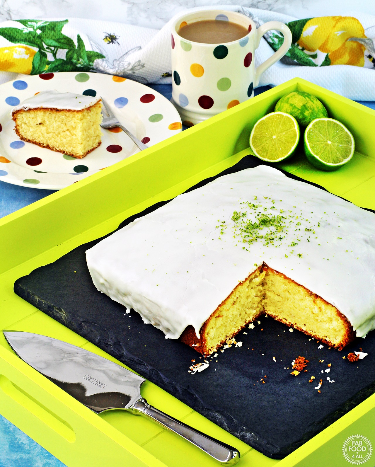 Easy Iced Lime Cake with cut slice.