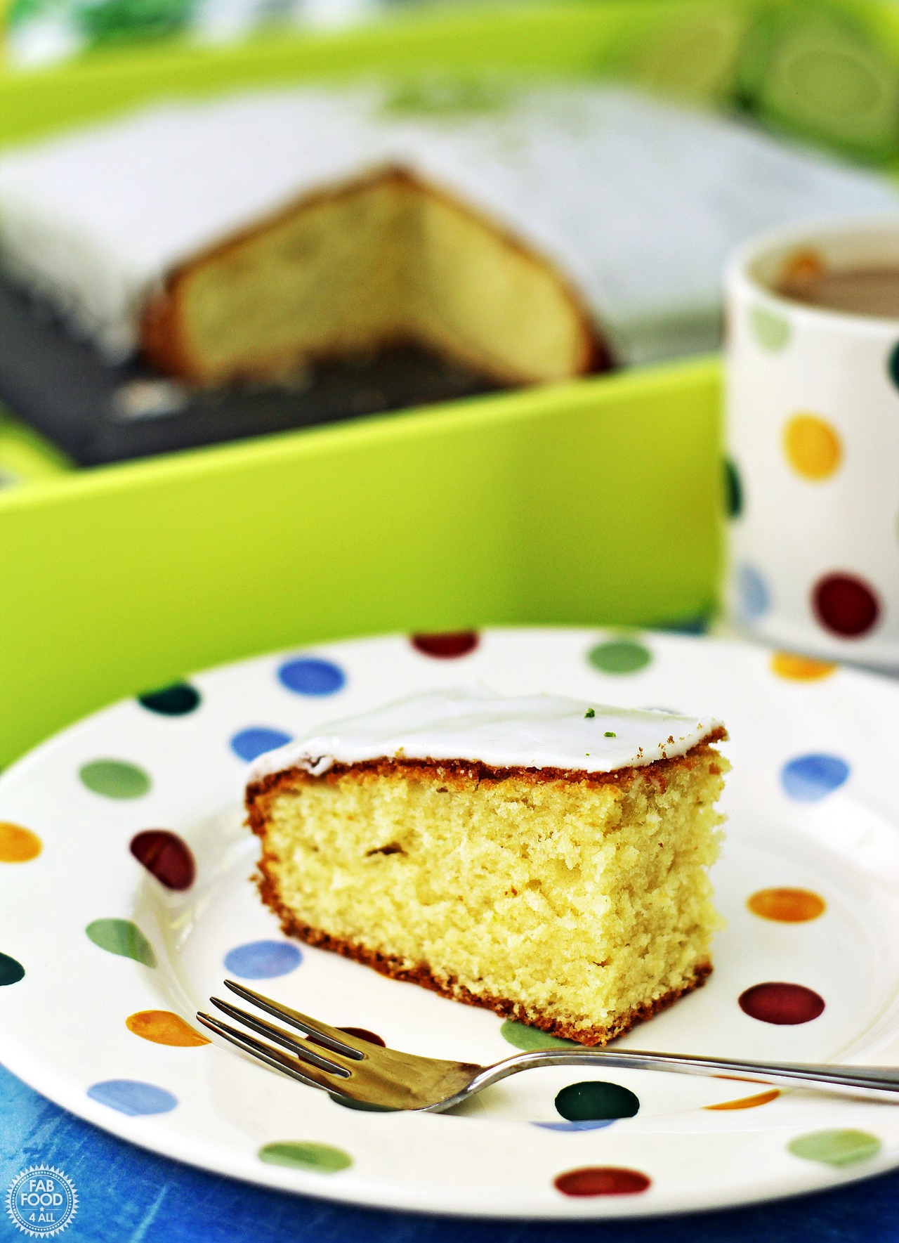 Easy Iced Lime Cake with slice on a plate.