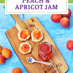 Jar of Peach & Apricot Jam with a spoon and scones on a wooden board surrounded by peaches, nectarines and apricots. Pinterest image.