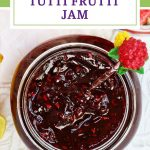 Tutti Frutti Jam in a jar with berries in background Pinterest image.