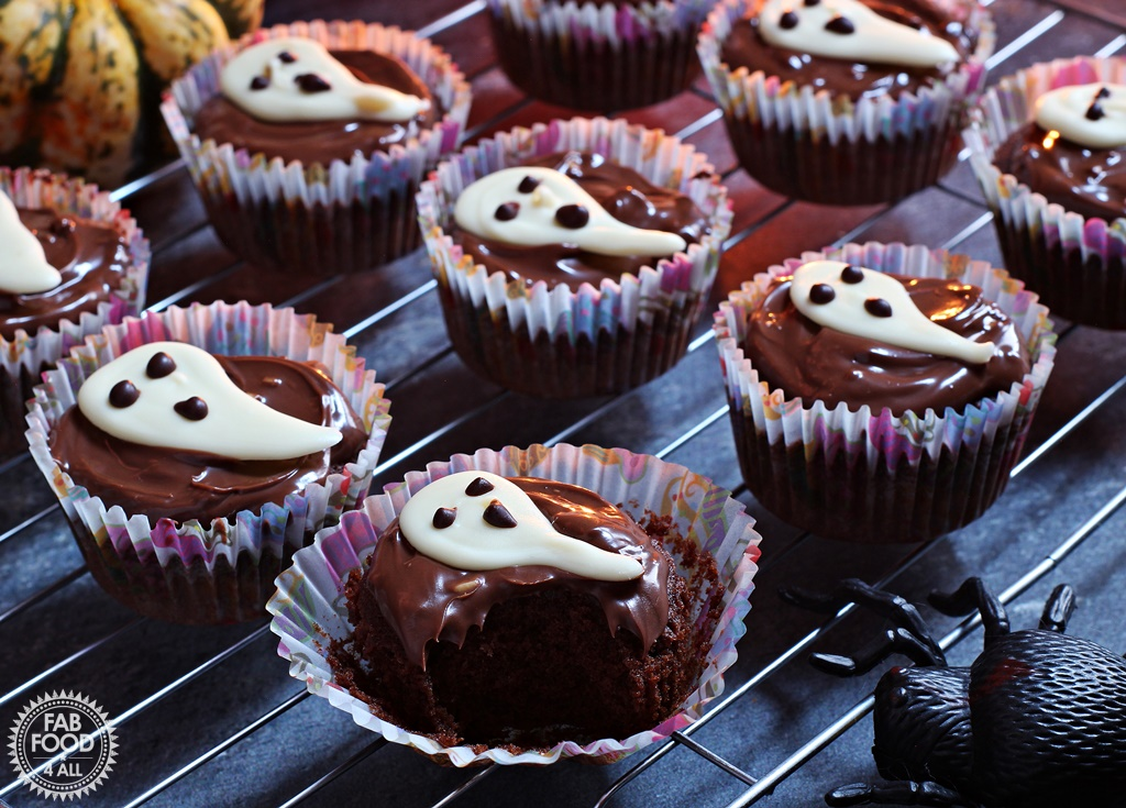 Easy Halloween Ghost Cupcakes - delicious chocolate & coffee flavoured sponge topped with chocolate spread & a handmade white chocolate ghost.
