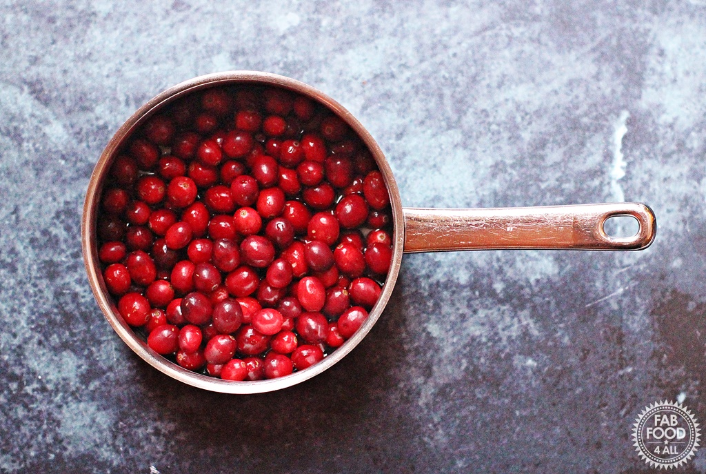 Easy Cranberry Curd, cranberries in a saucepan.