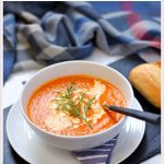 Tomato, Carrot & Dill Soup in a bowl with bread roll - Pinterest image