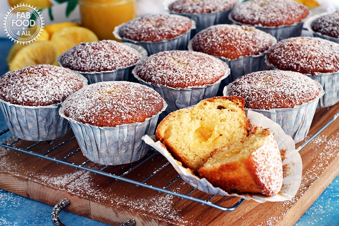 Easy Lemon Curd Muffins with a lemon curd centre and dusted with icing sugar. on a wire rack